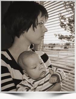 Women and baby by window